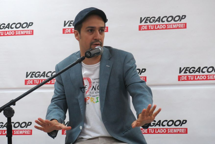 """Lin-Manuel Miranda speaks with reporters in Vega Alta, Puerto Rico, Wednesday, July 27, 2016. Miranda joked that he is a hard-to-catch Pokemon as fans pursue him with cellphones during a visit to his parents' native Puerto Rico shortly after ending his run on his Broadway hit """"Hamilton."""" (AP Photo/Danica Coto)"""