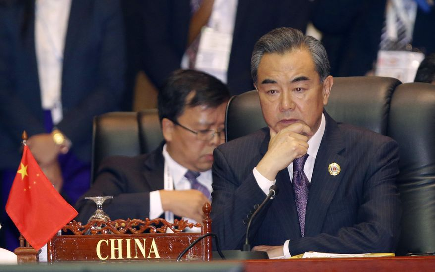 FILE- In this July 26, 2016, file photo, China's Foreign Minister Wang Yi, attends the 23rd ASEAN regional retreat meeting in Vientiane, Laos. Despite the Philippines taking on China in a territorial dispute in the South China Sea and winning big, other Southeast Asian nations with similar disputes who attended this week's meetings are apparently backing down from Beijing. (AP photo/Sakchai Lalit)