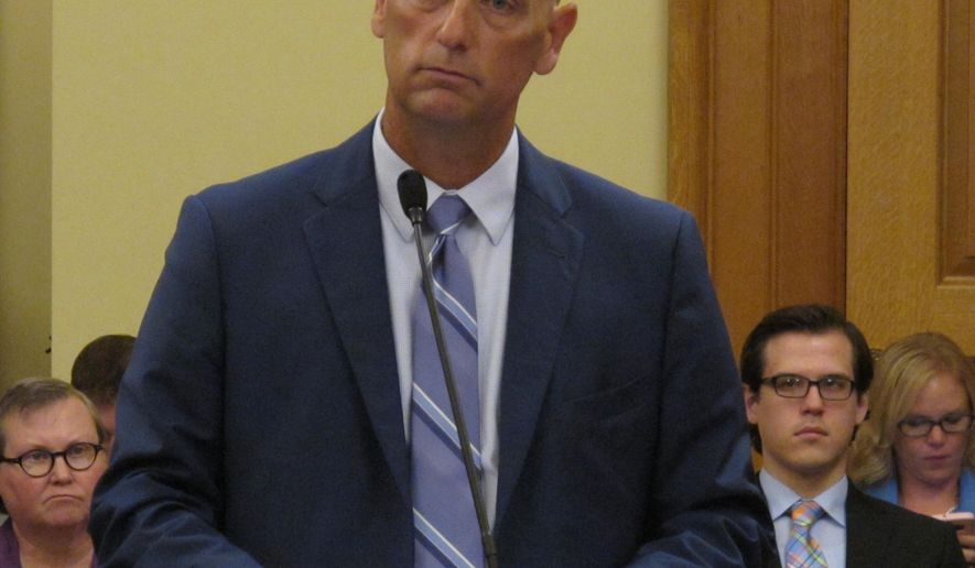 """Tim Keck, the interim secretary for the Kansas Department for Aging and Disability Services, answers questions for a legislative committee about Osawatomie State Hospital, Wednesday, July 27, 2016, at the Statehouse in Topeka, Kan. Keck says his agency will apply """"very, very, very soon"""" to regain federal certification for part of the hospital. (AP Photo/John Hanna)"""