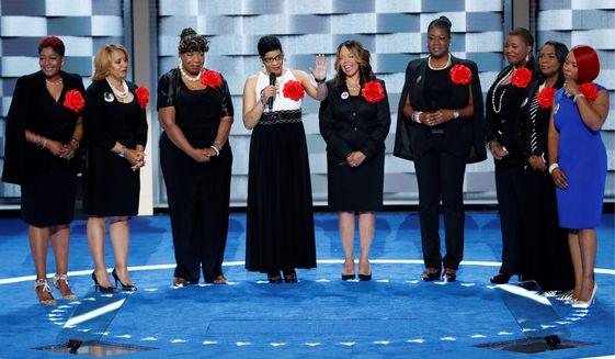 Sybrina Fulton, Geneva Reed-Veal, Lucy McBath, Gwen Carr, Cleopatra Pendleton, Maria Hamilton, Lezley McSpadden and Wanda Johnson from Mothers of the Movement speak during the second day of the Democratic National Convention on Tuesday in Philadelphia. (Associated Press)