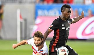 Toronto FC's Drew Moor, left, and D.C. United's Lloyd Sam vie for the ball during the first half of an MLS soccer match in Toronto on Saturday, July 23, 2016. (Frank Gunn/The Canadian Press via AP) **FILE**