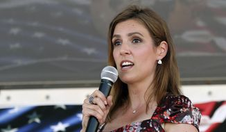 "Taya Kyle speaks about the statue of her late husband, Chris Kyle, before its unveiling Thursday, July 28, 2016 at the Chris Kyle Memorial Plaza in Odessa, Texas. A memorial for slain Navy Seal and ""American Sniper"" author Chris Kyle has been unveiled in the West Texas city where he was born in 1974. (Jacob Ford/Odessa American via AP) ** FILE **"
