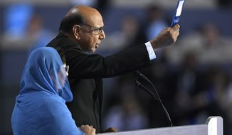 Khizr Khan, father of fallen US Army Capt. Humayun S. M. Khan, holds up his copy the United State Constitution as he speaks during the final day of the Democratic National Convention in Philadelphia , Thursday, July 28, 2016. (AP Photo/Mark J. Terrill)