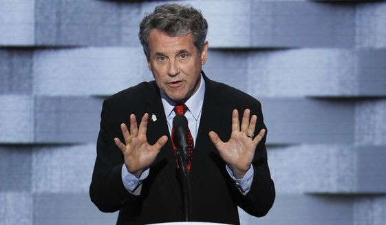 """""""Donald Trump thinks people in states like mine will choose his counterfeit campaign over the genuine solutions we're fighting for tonight,"""" said Sen. Sherrod Brown. """"He is wrong."""" (Associated Press)"""
