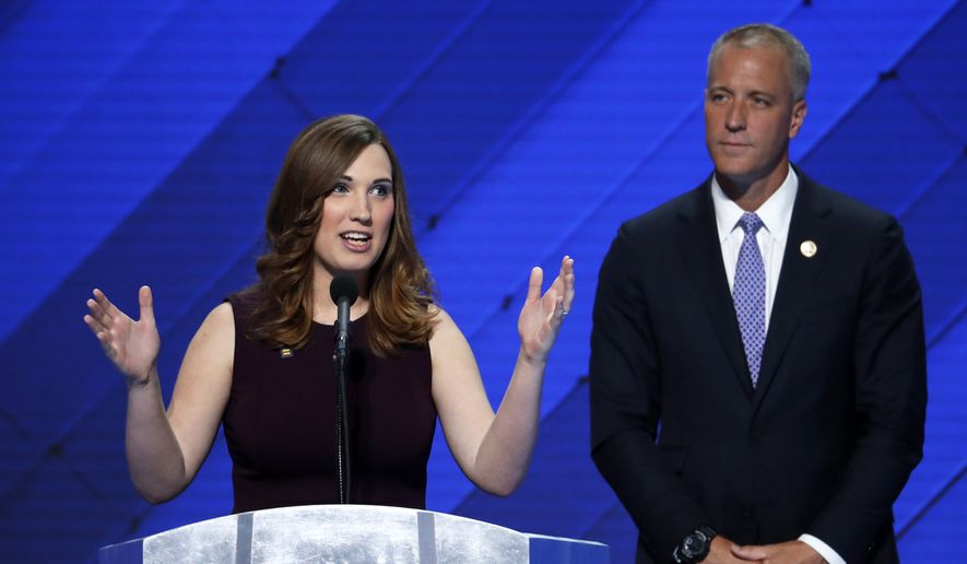 LGBT rights activist Sarah McBride speaks as Rep. Sean Patrick Maloney, D-NY, Co-Chair of the Congressional LGBT Equality Caucus listens during the final day of the Democratic National Convention in Philadelphia , Thursday, July 28, 2016. (AP Photo/J. Scott Applewhite)