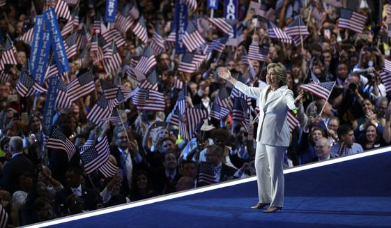 Hillary Clinton takes the stage during the final day of the Democratic National Convention on Thursday in Philadelphia. (Associated Press)
