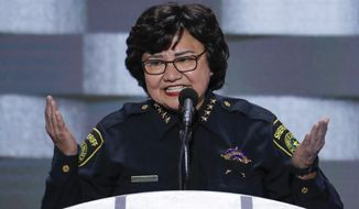 Dallas County Sheriff Lupe Valdez, whose city was the scene of the ambush that left five police officers dead and seven wounded earlier this month, asked for the moment of silence. (Associated Press)