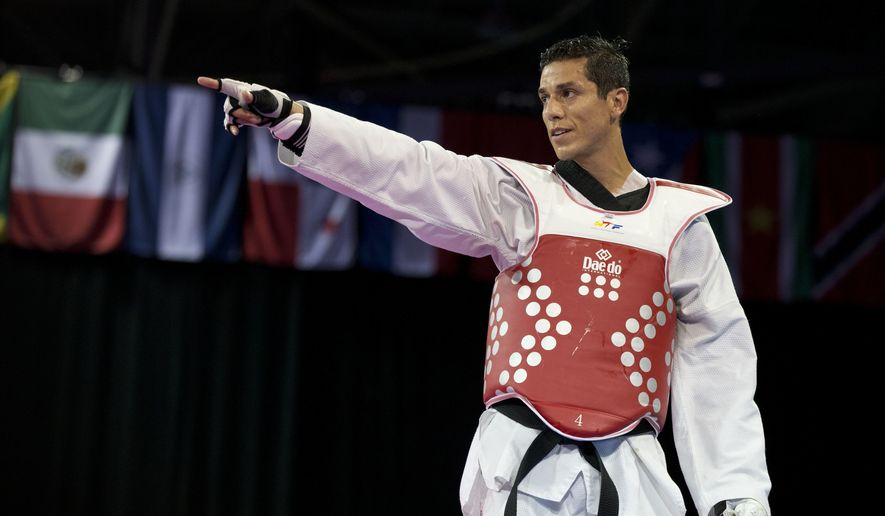 FILE - In this Tuesday, July 21, 2015 file photo, Steven Lopez of the U.S. reacts after winning a bronze medal by defeating Venezuela's Javier Medina in the men's taekwondo under-80kg category at the Pan Am Games in Mississauga, Ontario. The first time Lopez made the U.S. Olympic taekwondo team, he was just 15 years old. Now, at 37, he qualified again and will likely be the oldest athlete competing in taekwondo at the Rio de Janeiro games. (AP Photo/Rebecca Blackwell, File)