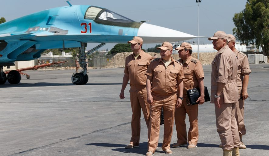 Russian Defense Minister Sergei Shoigu (second left) visits the Hemeimeem air base in Syria on June 18, 2016. Shoigu said on July 28, 2016, that Russia and the Syrian government will open humanitarian corridors and offer a way out for Islamic State fighters wanting to lay down their arms. (Vadim Savitsky/Russian Defense Ministry Press Service Pool Photo via AP) **FILE**
