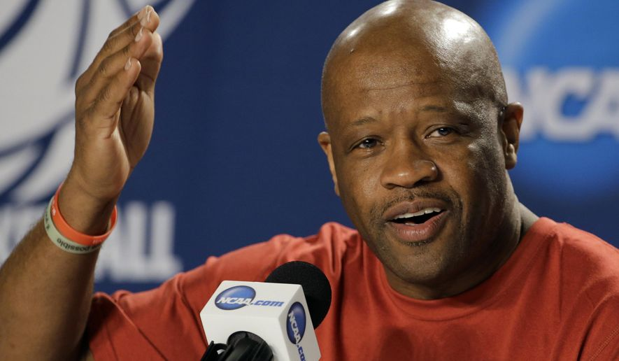 FILE - In this March 20, 2015 file photo, Arkansas head coach Mike Anderson gestures during a news conference at the NCAA college basketball tournament in Jacksonville, Fla.  Anderson believes missing the NCAA Tournament last season was an abberation, not a trend. The Razorbacks, loaded with an influx of junior-college talent, will have an early chance to prove their coach correct on a preseason tour of Spain next month.  (AP Photo/Chris O'Meara, File)