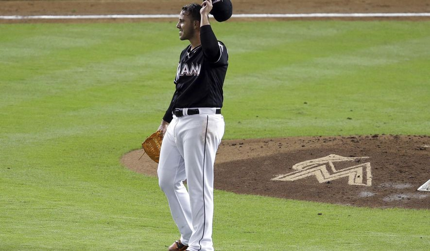 Miami Marlins starting pitcher Jose Fernandez reacts after giving up a home run to St. Louis Cardinals' Matt Holliday during the third inning of a baseball game, Thursday, July 28, 2016, in Miami. The Cardinals hit two home runs and scored three runs in the inning. (AP Photo/Lynne Sladky)