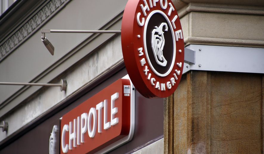 This Monday, Feb. 8, 2016, photo, shows the marquis signs for the Chipotle restaurant in Pittsburgh's Market Square. Chipotle announced Thursday, July 28, 2016, that the company's first Tasty Made burger restaurant will open in the fall in Lancaster, Ohio. No other details were immediately available. (AP Photo/Keith Srakocic)