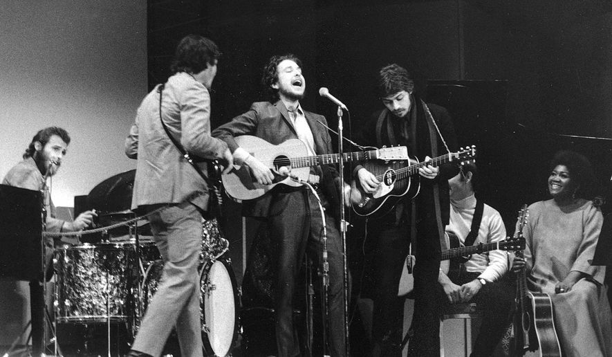 FILE - In this Jan. 20, 1968 file photo, Bob Dylan, center, performs with drummer Levon Helm, left, Rick Danko, second left, and Robbie Robertson of The Band at Carnegie Hall in New York, in Dylan's first public appearance after his 1966 motorcycle accident. Dylan's tumble from his Triumph 50 years ago, was the most analyzed motorcycle crash in pop-culture history, but for all its importance, details surrounding the crash remain foggy. (AP Photo, File)