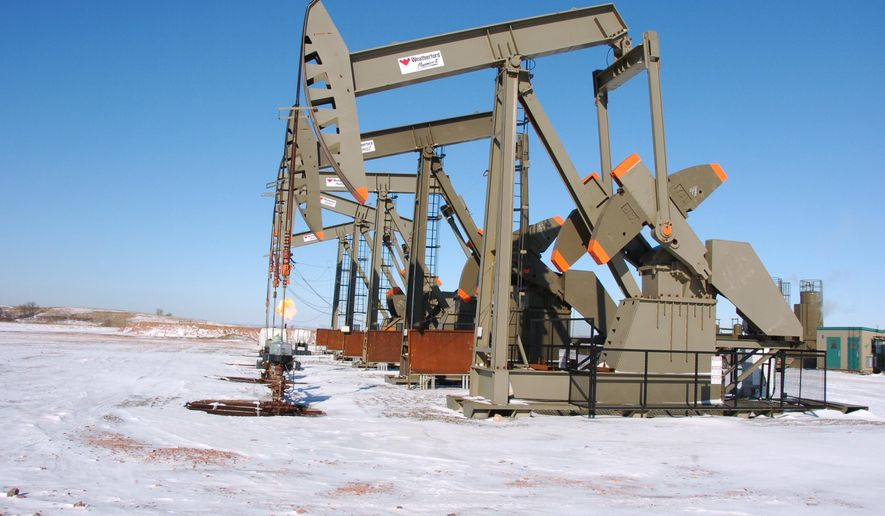 This Feb. 26, 2015 photo, shows an oil well on the Fort Berthold Indian Reservation near Mandaree, North Dakota. U.S. officials announced plans Thursday, July 28, 2016, to speed up permitting for oil and gas drilling on federal and American Indian lands to reduce delays, as applications were projected to be down amid an ongoing price slump. (AP Photo/Matthew Brown)