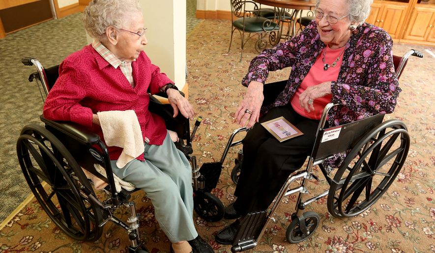 In this July 26, 2016 photo, Elsie Kopel, left, and Alice Ruter, both 105-years-old, who share the same birthday, April 9, 1911, chat at the Western Home Stanard Family Assisted Living in Cedar Falls, Iowa. (Brandon Pollock/The Courier via AP)
