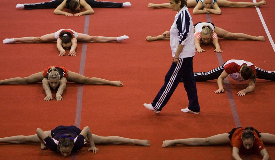 In this May 7, 2008, photo, Martha Karolyi watches as gymnasts stretch during USA Gymnastics National Team training at the Karolyi Ranch, in Huntsville, Texas. As his wife Martha Karolyi prepares to step down as USA Gymnastics national women's team coordinator, Bela Karolyi is taking steps to ensure the future of the gymnastics oasis he established in the Sam Houston National Forest, and, also, to contemplate his own mortality. (Smiley N. Pool/Houston Chronicle via AP)