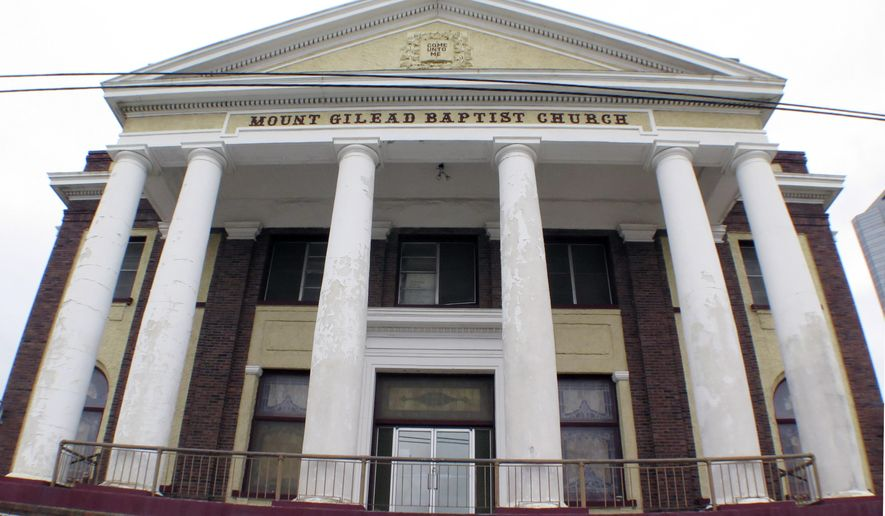 ADVANCE FOR MONDAY AUG. 1 - This Sunday, May 15, 2016 photo shows theMount Gilead Baptist Church in downtown Fort Worth, Texas.  Mount Gilead Baptist Church is safe for now. A state district judge recently granted a restraining order that keeps the future of the historic black church, which was offered for sale this spring, in limbo, the latest move in a bitter legal battle that has pitted church members against their pastor and deacons. (Ron T. Ennis/Star-Telegram via AP)