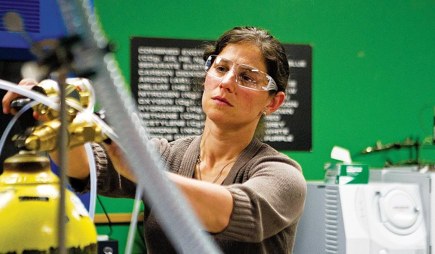 In this July 7, 2016 photo, University of Wyoming engineering professor Erica Belmont works in her lab in Laramie, Wyo.  A NASA grant supports the unique research into low-temperature flames at the University of Wyoming. (Shannon Broderick/Laramie Daily Boomerang via AP)