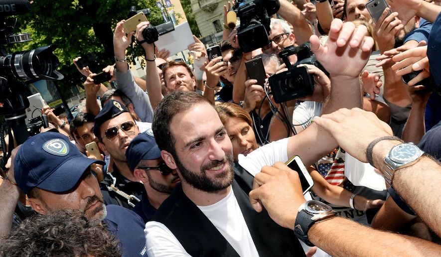Argentinian striker Gonzalo Higuain arrives in the team headquarters in Turin, Italy, Wednesday July 27, 2016. Italian champion Juventus said Tuesday it has signed  Higuain from Serie A rival Napoli for 90 million euros ($99 million). (Alessandro Di Marco/Ansa via Ap)