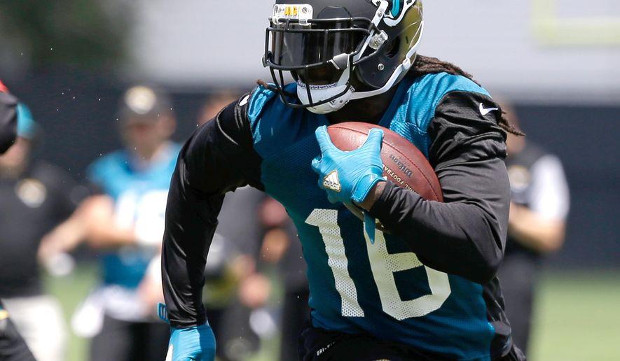 Jacksonville Jaguars running back Denard Robinson gains yardage in a scrimmage during NFL football training camp, Thursday, July 28, 2016, in Jacksonville, Fla. (AP Photo/John Raoux)