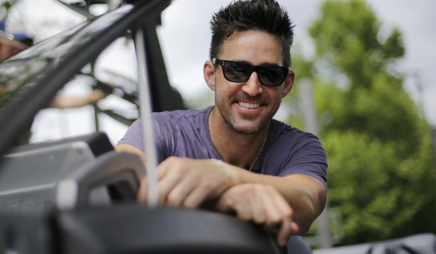 """In this June 21, 2016 photo, Country music star Jake Owen poses in his boat on the Cumberland River near Nashville, Tenn. Owen's latest album, """"American Love,"""" comes out on Friday, July 29. (AP Photo/Mark Humphrey)"""