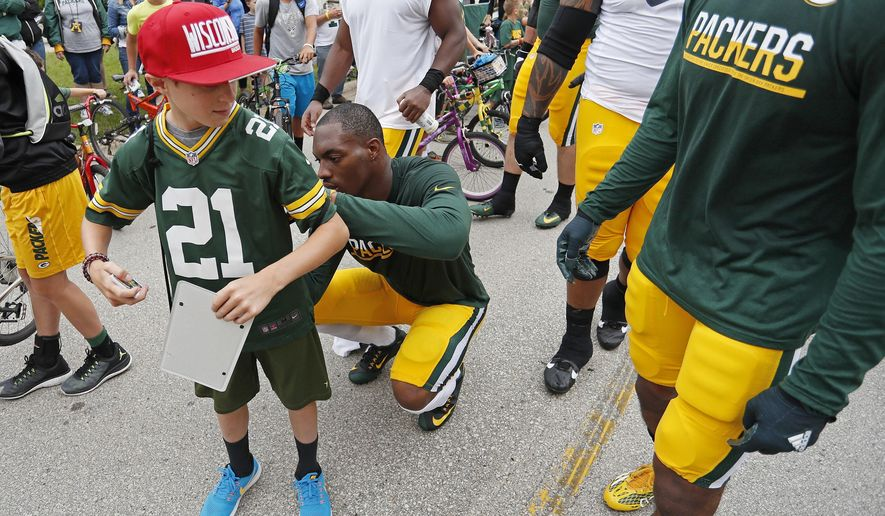 Green Bay Packers free safety Ha Ha Clinton-Dix signs a fans jersey during NFL football training camp, Thursday, July 28, 2016, in Green Bay, Wis. (AP Photo/Matt Ludtke)