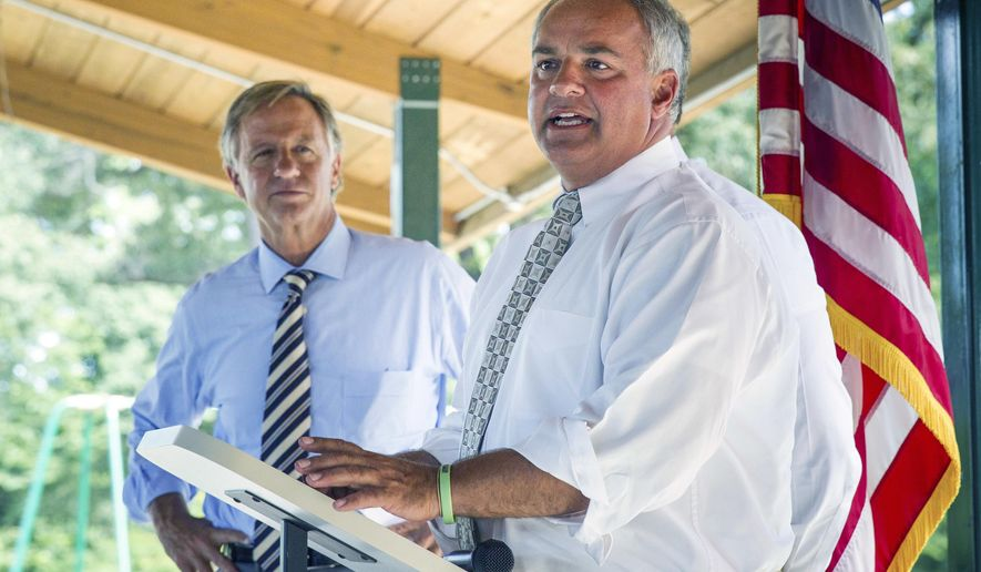 In this Tuesday, July 26, 2016 photo State Rep. Tim Wirgau, R-Buchanan, right, speaks at a grant announcement in Camden, Tenn. as Republican Gov. Bill Haslam looks on. Haslam says he has been happy to lend his support to state lawmakers facing tough primary challenges while making grant announcements around the state. (AP Photo/Erik Schelzig)
