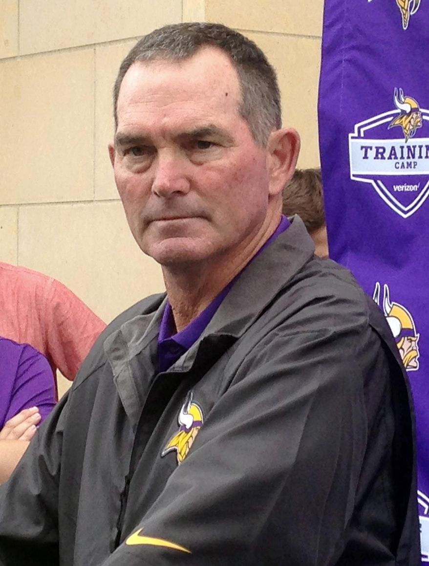Minnesota Vikings head NFL football coach Mike Ziimmer listens to a question from the media Thursday, July 28, 2016, in Mankato, Minn. where players will report Friday for camp. The Vikings have given Zimmer a contract extension. He is 18-14 in two years, including an 11-5 regular-season record and an NFC North division title last year. (AP Photo/Dave Campbell)