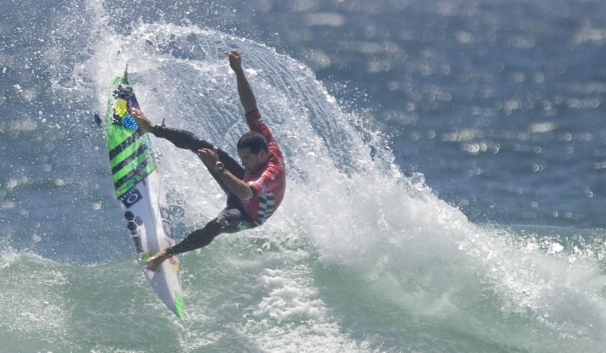 World champion surfer Adriano De Souza takes first place in round two of the U.S. Open of Surfing on Tuesday, July 26, 2016 in Huntington Beach, Calif. (Mindy Schauer/The Orange County Register via AP)