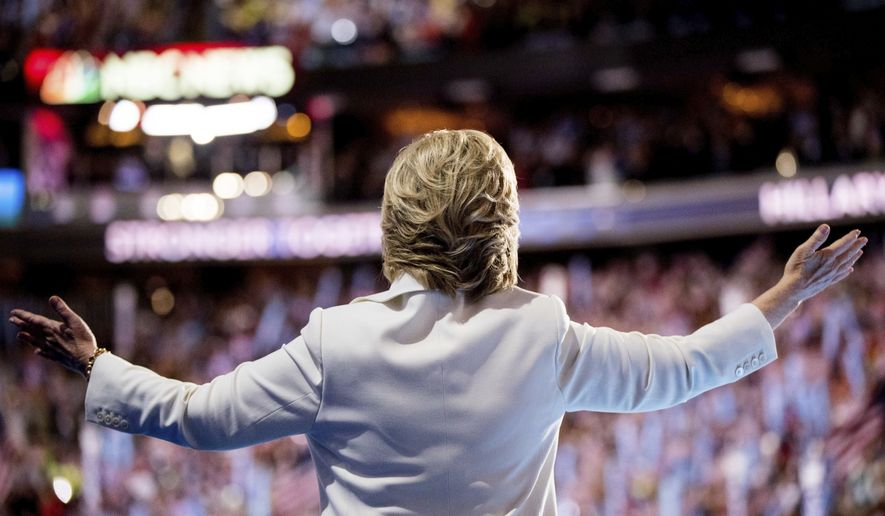 Democratic presidential candidate Hillary Clinton waves to the crowd as she takes the stage to speak during the fourth day session of the Democratic National Convention in Philadelphia, Thursday, July 28, 2016. (AP Photo/Andrew Harnik)