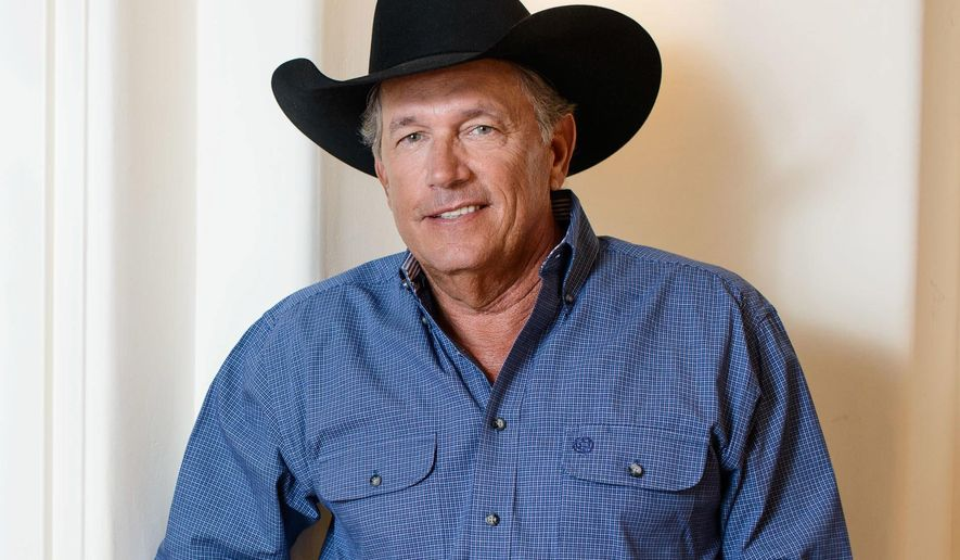 FILE - In this Sept. 22, 2015, file photo, country music legend George Strait poses for a portrait in Las Vegas. Strait will honor singer-songwriter Jim Lauderdale with a lifetime achievement award at the Americana Honors and Awards Show on Sept. 21, 2016, in Nashville, Tenn. (Photo by Al Powers/Powers Imagery/Invision/AP, File)