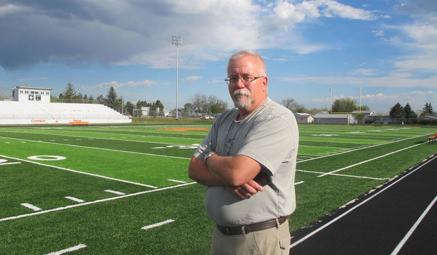 Killdeer Public School Superintendent Gary Wilz says night football games may have to be delayed while field lights are repaired.  Killdeer school officials are dealing with more than $1 million in storm damage as they prepare for the start of fall classes. A July 10 hail storm that town officials have said was one of the worst local disasters in memory damaged school buildings, buses and even the football field. (Lauren Donovan /The Bismarck Tribune via AP)
