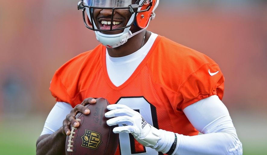 FILE - In this April 19, 2016, file photo, Cleveland Browns' Robert Griffin III smiles during practice at the NFL football team's minicamp in Berea, Ohio. Griffin III is excited to have a chance to resurrect his career in Cleveland after it fell apart with Washington. (AP Photo/David Dermer, File)