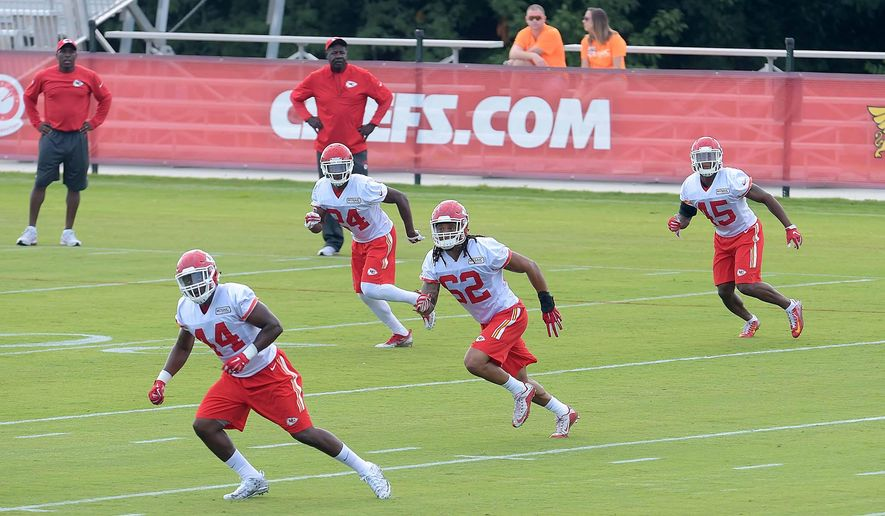 Kansas City Chiefs defensive team members, including Terrance Smith (62), D.J. White (24) and Tre Jones (45) run a drill during NFL football training camp Thursday, July 28, 2016, in St. Joseph, Mo. (Jessica A. Stewart/St. Joseph News-Press via AP)