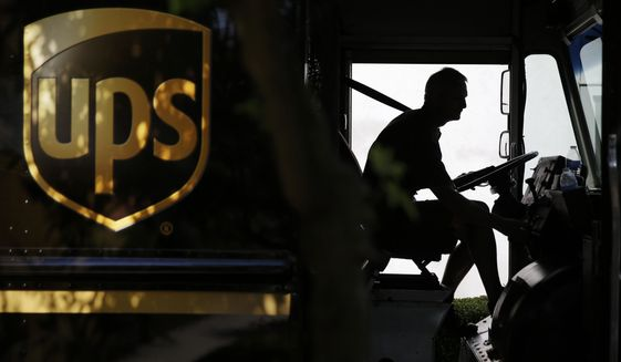 FILE - In this June 20, 2014, file photo, a United Parcel Service driver starts his truck after making a delivery in Cumming, Ga. UPS reports financial results on Friday, July 29, 2016. (AP Photo/David Goldman, File)