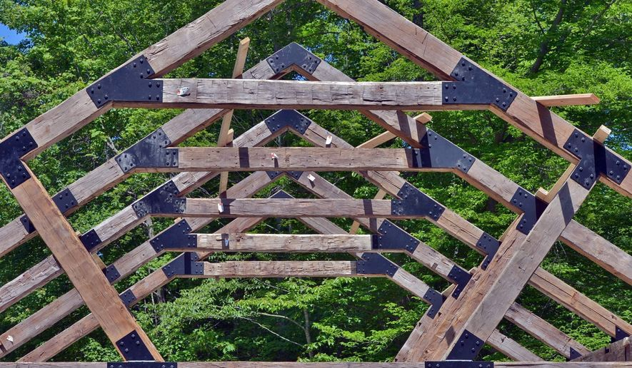 ADVANCE FOR USE SUNDAY, JULY 31, 2016 AND THEREAFTER - This May 23, 2016, photo shows steel brackets from the 21st century connect timbers from a 19th-century Canadian barn to form the frame for a new pavilion at the Wild Rock development on the rim of the New River Gorge in Lansing, W. Va. (Tom Hindman/Charleston Gazette-Mail via AP)