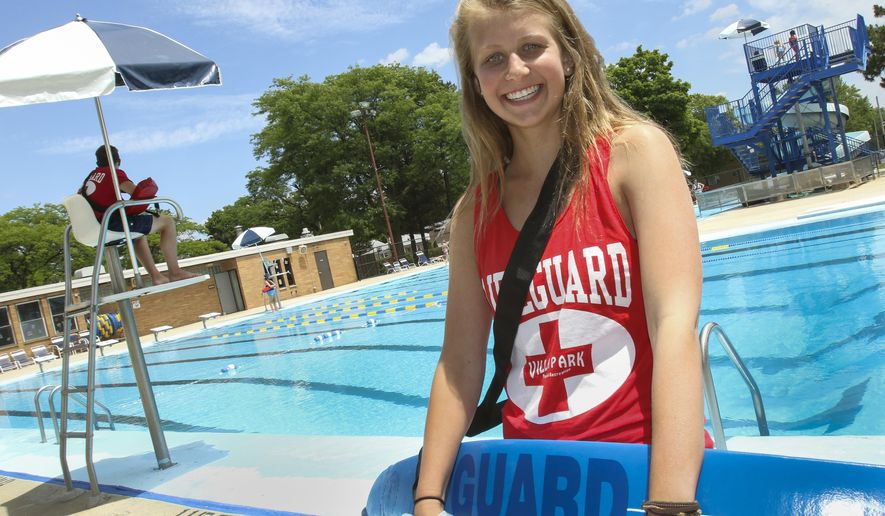 ADVANCE FOR USE SATURDAY, JULY 30 AND THEREAFTER - In this June 30,  2016 photo, lifeguard Katie Karcz poses at Jefferson Pool in Villa Park, Ill. When Karcz recently saw a boy jump off a diving board and sink to the bottom, she knew what she had to do, she blew her whistle three times and jumped in to save him. It was a move any experienced lifeguard would make, except, in this case, it was Karcz's first day working at the pool. (Bev Horne/Daily Herald, via AP)