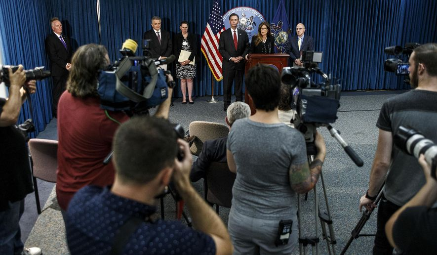 Attorney General Kathleen Kane announces the agreement her office has reached with the Hershey Trust Company and the Milton Hershey School that implements significant reforms to improve the operation and governance of both entities, Friday, July 29, 2016, in Harrisburg, Pa. (Dan Gleiter/PennLive.com via AP)