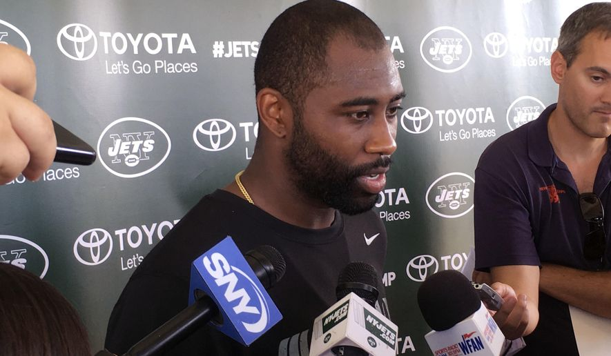 New York Jets cornerback Darrelle Revis speaks to reporters during NFL football training camp, Friday, July 29, 2016 in Florham Park, N.J. New York Jets cornerback Darrelle Revis says there's no timetable for when he will fully practice as he continues to recover from offseason wrist surgery. (AP Photo/Dennis Waszak, Jr.)