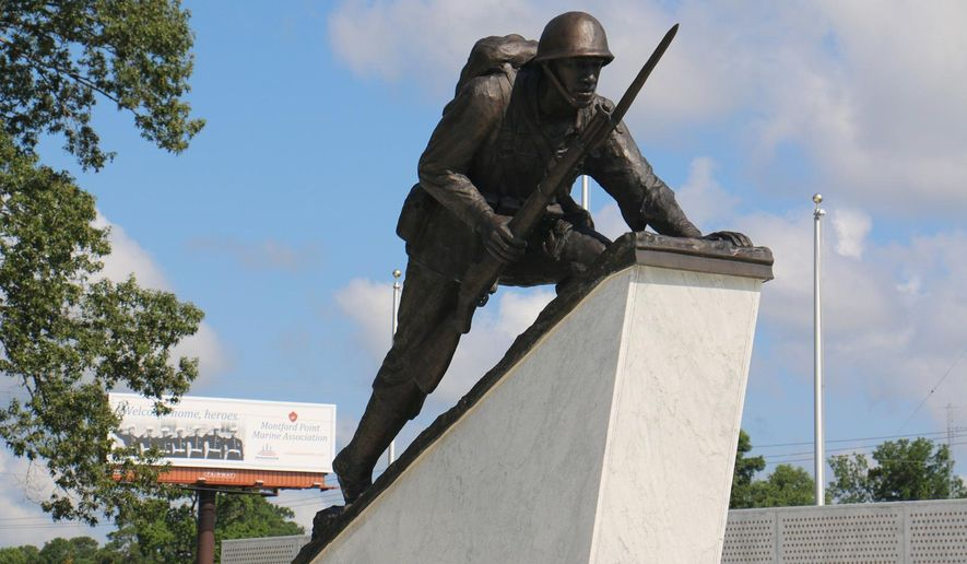 In this Sept. 21, 2015 photo provided by the City of Jacksonville, the monument for the Montford Point Marines, the nation's first black Marines, is seen in Jacksonville, N.C. Forty-five Montford Point Marines are scheduled to attend the dedication Friday, July 29, 2016, at Lejeune Memorial Gardens. (Lisa Miller, City of Jacksonville via AP)