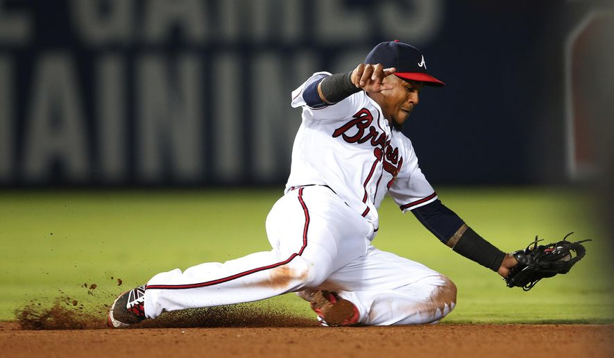 Atlanta Braves shortstop Erick Aybarmakes play on a ground ball by Philadelphia Phillies' Cesar Hernandez during the seventh inning of a baseball game Friday, July 29, 2016, in Atlanta. Hernandez was out at first base. (AP Photo/John Bazemore)