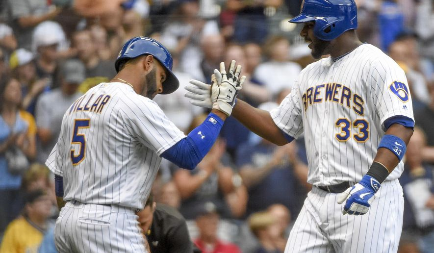 Milwaukee Brewers' Chris Carter, right, is greeted by Jonathan Villar after hitting a two-run home run during the first inning of a baseball game against the Pittsburgh Pirates on Friday, July 29, 2016, in Milwaukee. (AP Photo/Benny Sieu)