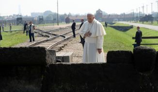 Pope Francis prays in front of the Memorial at the former Nazi Death Camp Auschwitz-Birkenau, in Oswiecim, Poland, Friday, July 29, 2016. Pope Francis paid a somber visit to the Nazi German death camp of Auschwitz-Birkenau Friday, becoming the third consecutive pontiff to make the pilgrimage to the place where Adolf Hitler's forces killed more than 1 million people, most of them Jews. (L'Osservatore Romano /Pool Photo via AP)