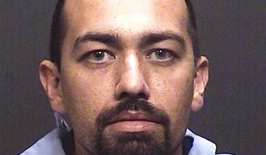 This undated booking photo provided by the Tucson Police Department shows Jesus Isaac Rael. Rael, a bank robbery suspect who was fatally shot by police after leading officers on a chase, stealing a police car, carjacking a citizen's vehicle and shooting at officers during two separate confrontations. Police say the series of events Thursday afternoon began in southwest Tucson when Marana police tried to stop the suspect wanted in a Wednesday bank robbery.(Tucson Police Department via AP)