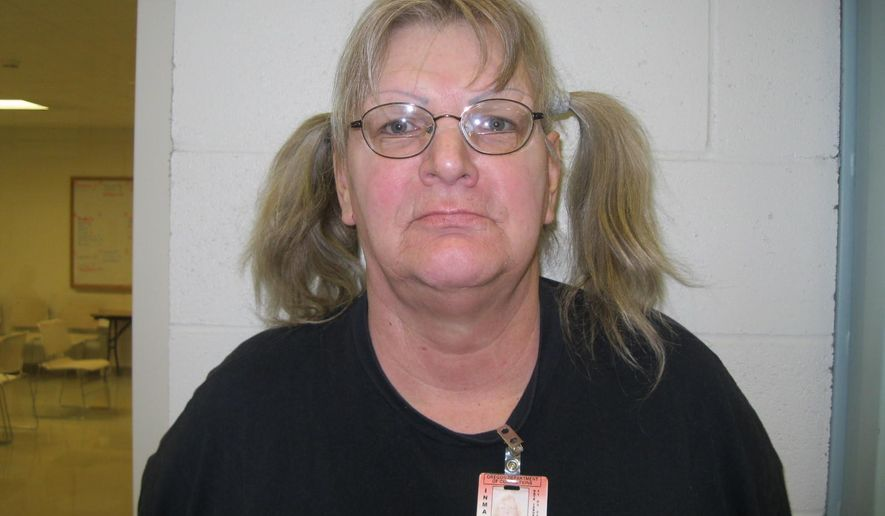 In this undated inmate mug released by the Oregon Department of Corrections shows inmate Linda Patricia Thompson in Salem, Ore. Federal authorities say Thompson, who was recently released from prison in Oregon, robbed a bank in Wyoming on Wednesday, July 27, 2016, only to throw the cash up in the air outside the building and sit down to wait for police. (Oregon Department of Corrections via AP)