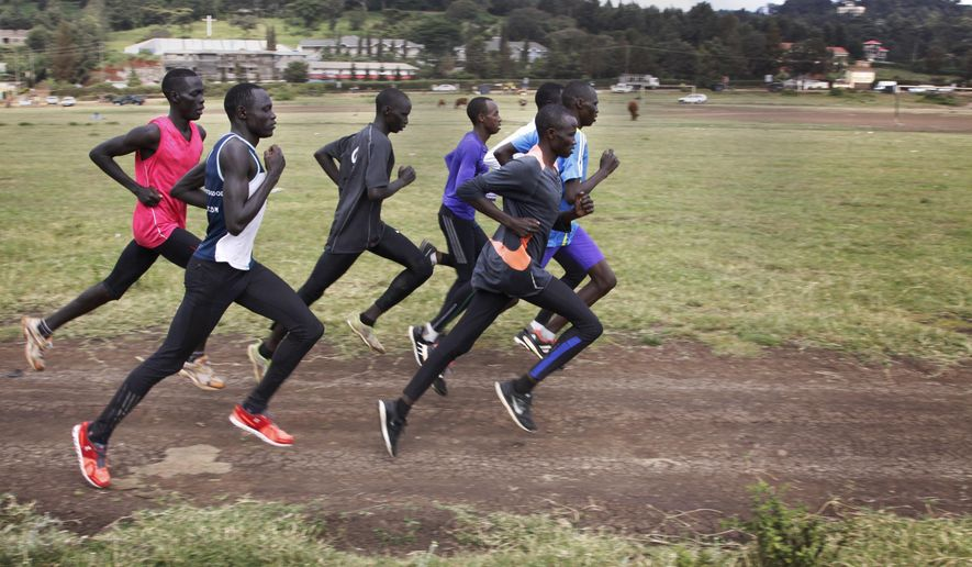 In this photo taken Thursday, June 30, 2016,  Paulo Amotun Kokoro, left foreground, runs during a training session in Ngong, Kenya.  Kokoro is one of five runners from South Sudan that grew up in a refugee camp and are part of the IOC's first refugee team that will be competing at the Rio Olympics.  (AP Photo/Khalil Senosi)