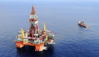 In this May 7, 2012, file photo released by China's Xinhua News Agency, Haiyang Shiyou oil rig, the first deep-water drilling rig developed in China by the China National Offshore Oil Corp., is pictured at 320 kilometers (200 miles) southeast of Hong Kong in the South China Sea. (Jin Liangkuai/Xinhua News Agency via AP, File)