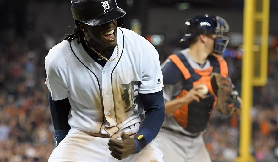 Detroit Tigers' Cameron Maybin celebrates after scoring  a run in the sixth inning after Astros second baseman Jose Altuve dropped a pop fly off the bat of Miguel Cabrera in shallow right field with two outs, in a baseball game Saturday, July 30, 2016, in Detroit. (AP Photo/Lon Horwedel)