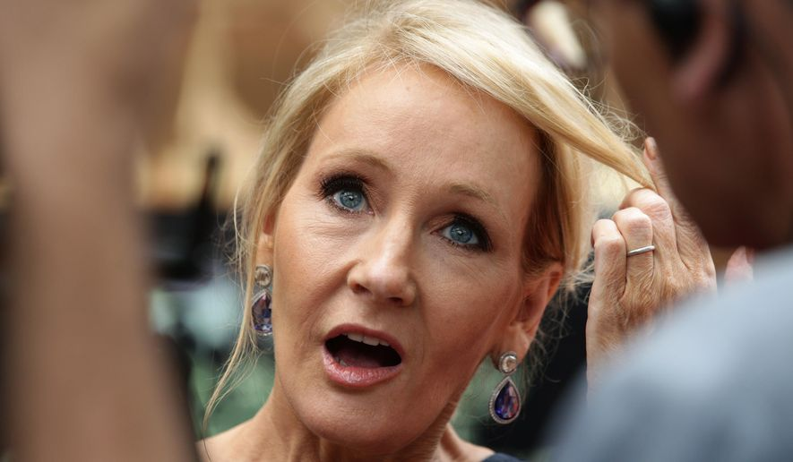 Writer J.K. Rowling arrives at gala performance of Harry Potter and the Cursed Child, at the Palace Theatre in central London, Saturday, July 30, 2016. Based on an original new story by J.K. Rowling, John Tiffany and Jack Thorne, it is the eighth story in the Harry Potter series and is the first of the stories to be presented on stage. (Yui Mok/PA via AP)