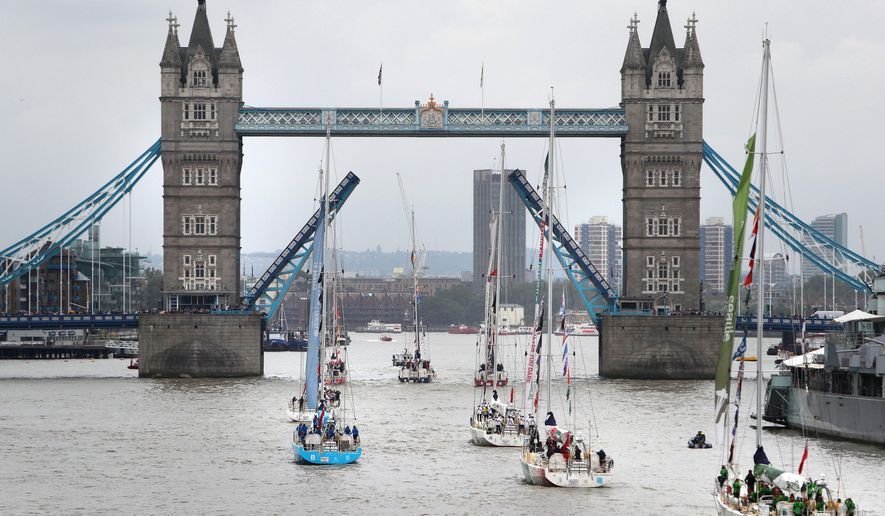 London's Tower Bridge opens its gates to welcome home the 12-strong fleet of the biennial Clipper Round the World yacht race, Saturday, July 30, 2016. Late on Friday night the fleet crossed the official race finish line in Southend, after a 30-hour tightly-fought battle across 198 nautical miles of the North Sea. (Steve Parsons/PA via AP)